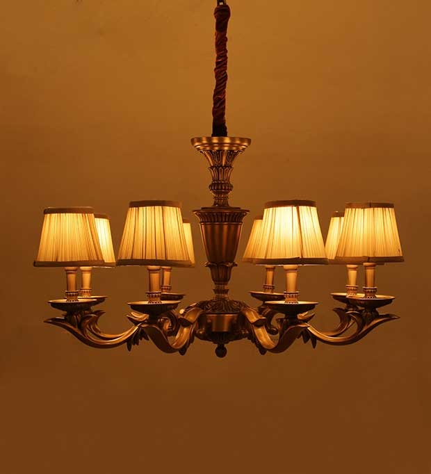Antique brass finish casted chandelier with pleated fabric shades aloadofball Image collections